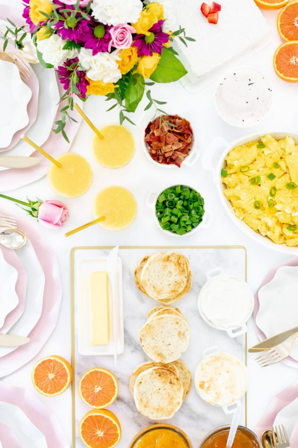 spring brunch spread with eggs, english muffins and orange juice