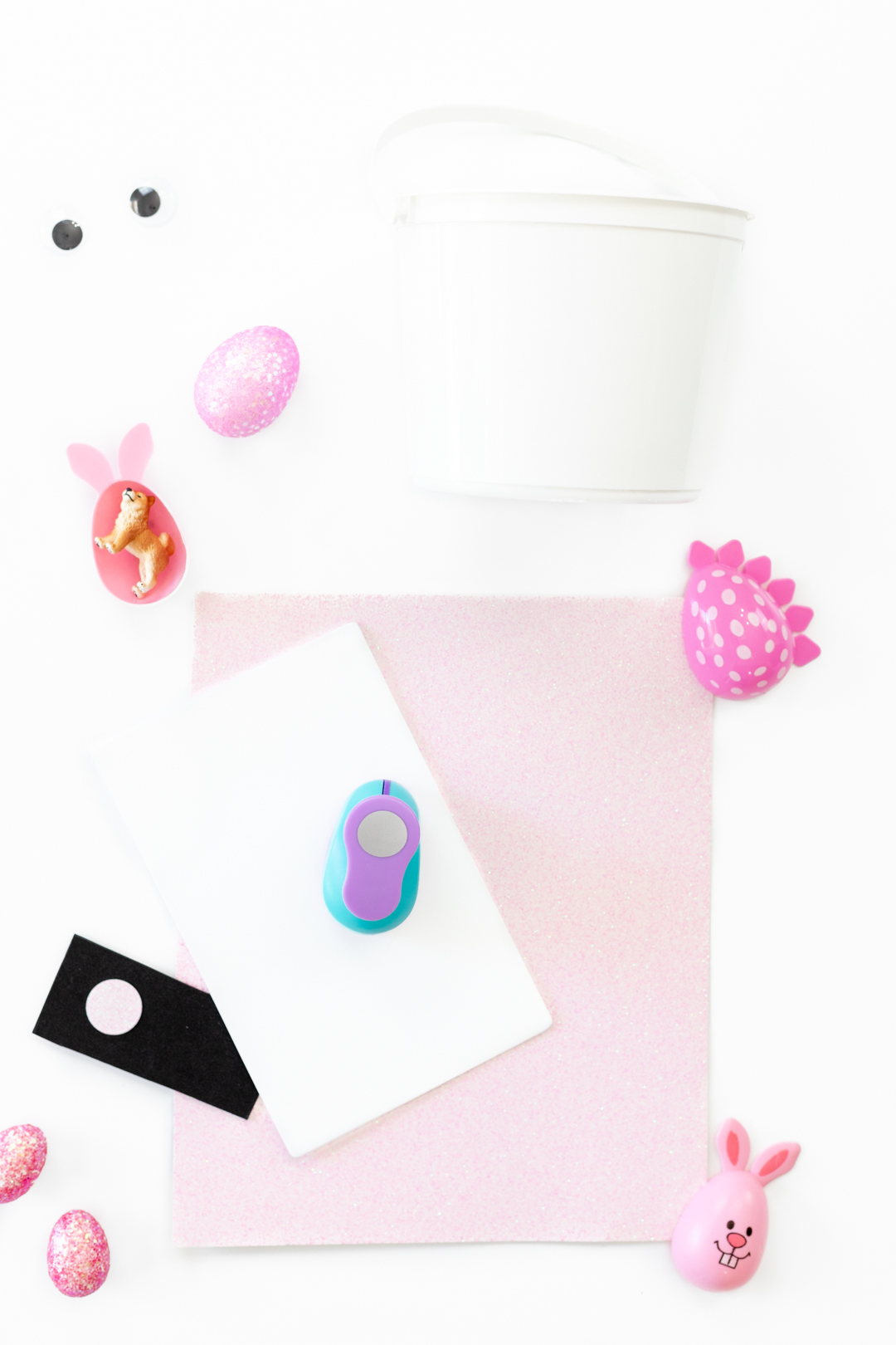 diy easter basket items. glitter paper, foam, glue, hole punch