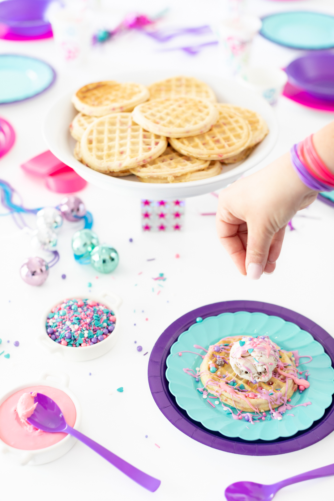 adding sprinkles to waffle creation