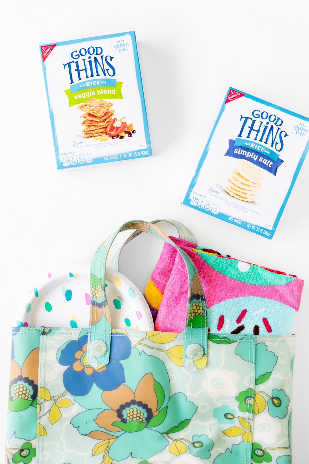 beach bag with towel, plates and crackers