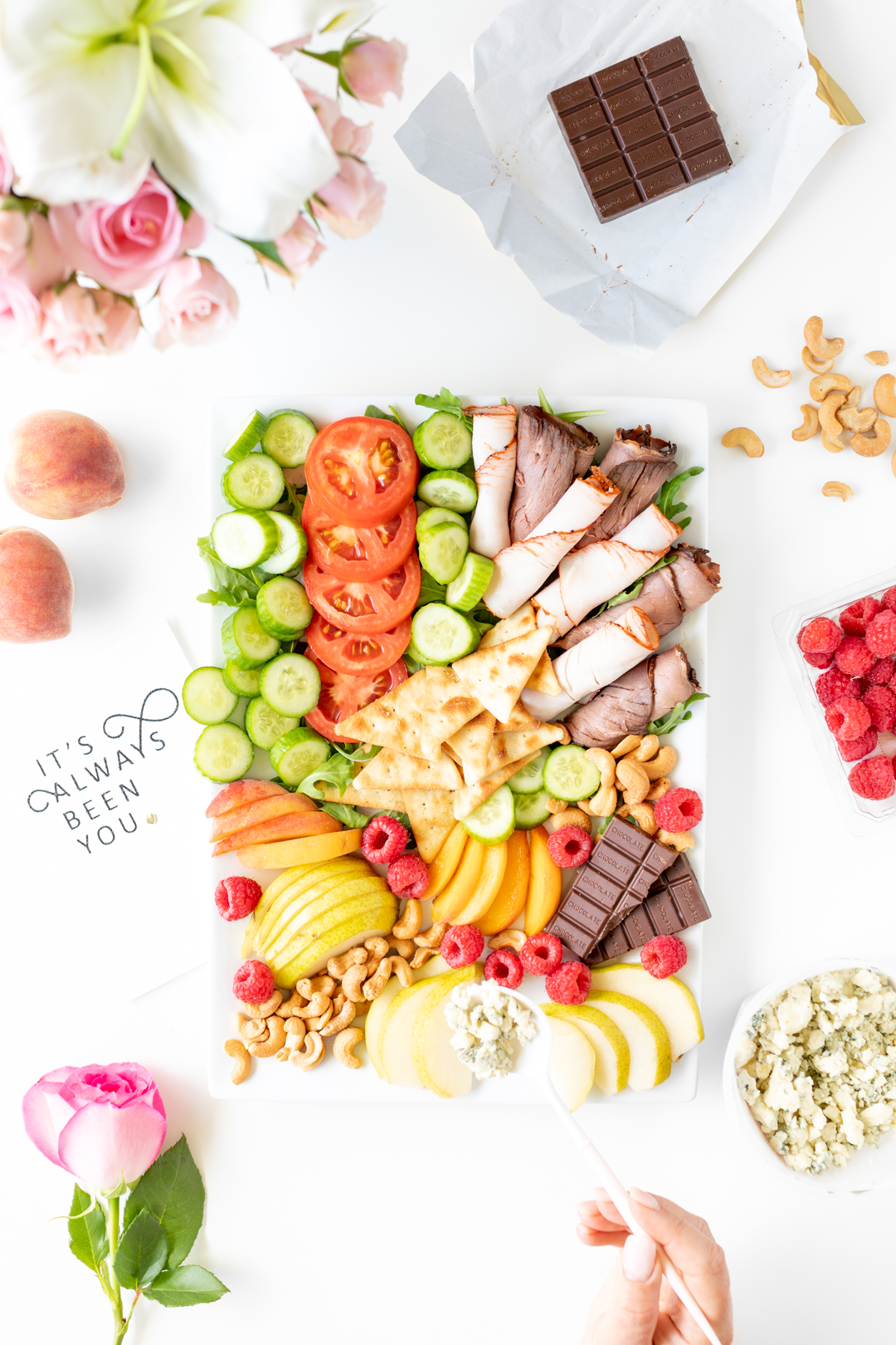 date night snack tray with meats, veggies and dessert