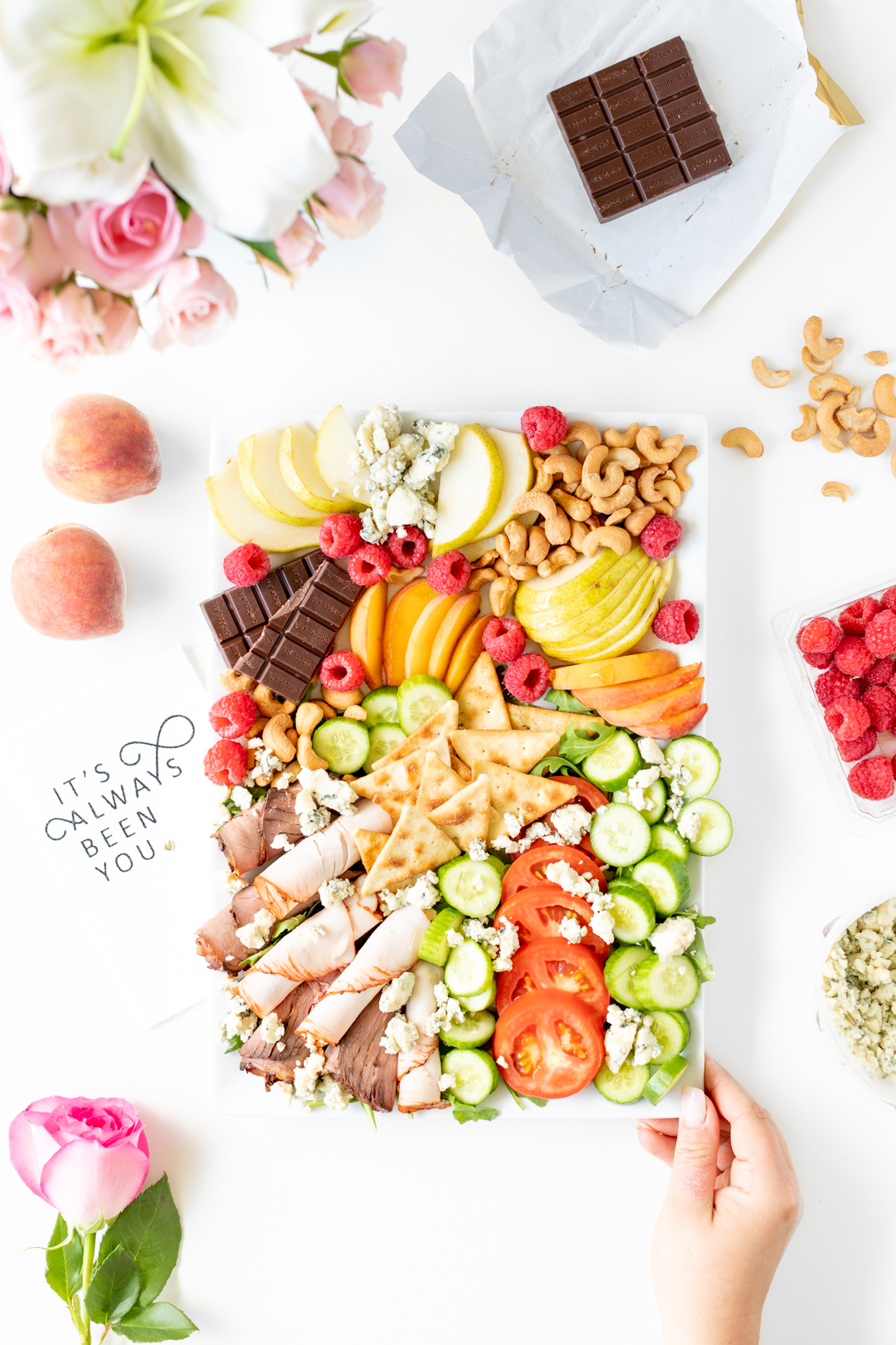 snack tray with fresh chopped vegetables, fruits, meats and cheeses.