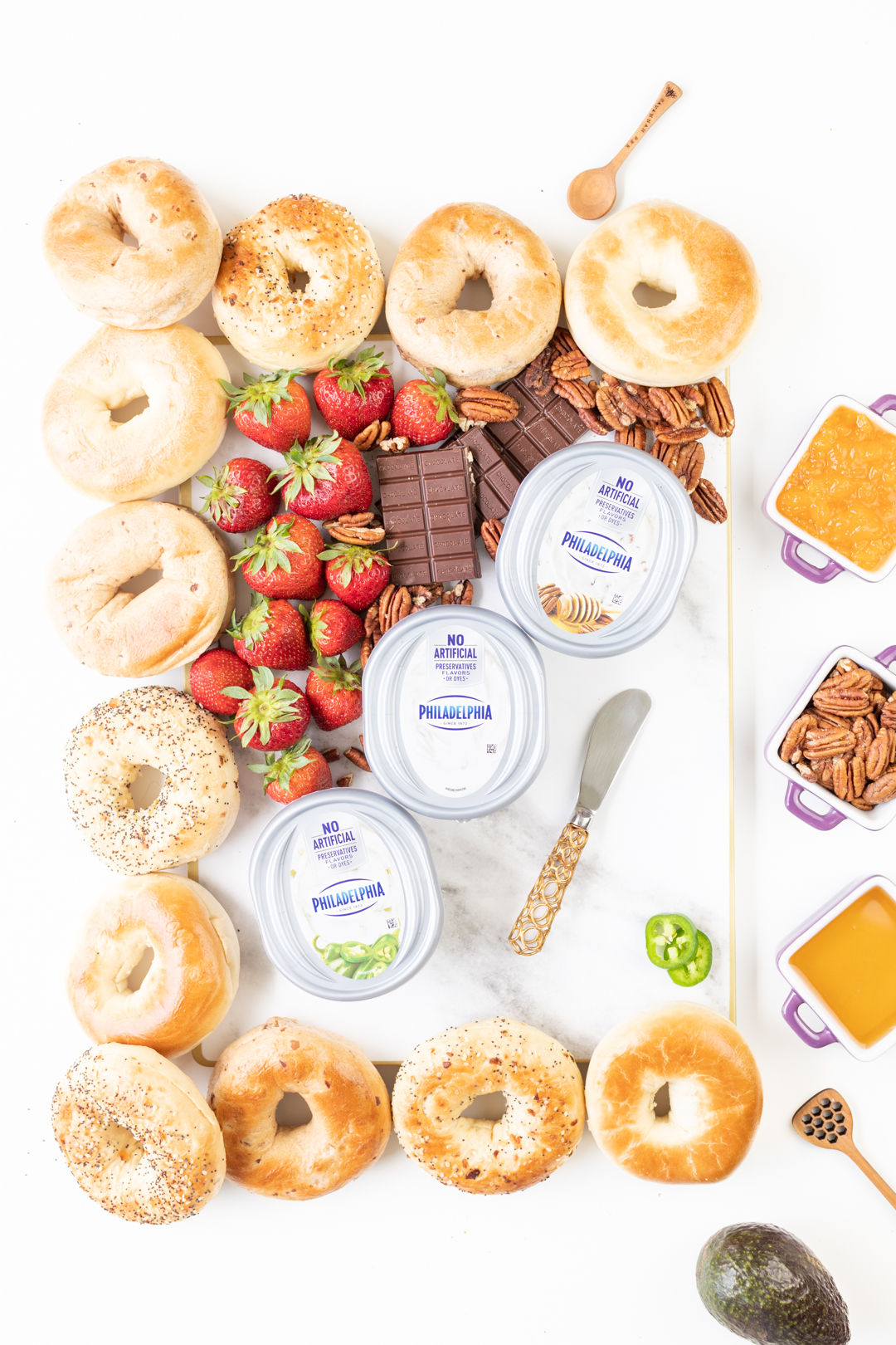 Setting up a breakfast board with bagels and spreads