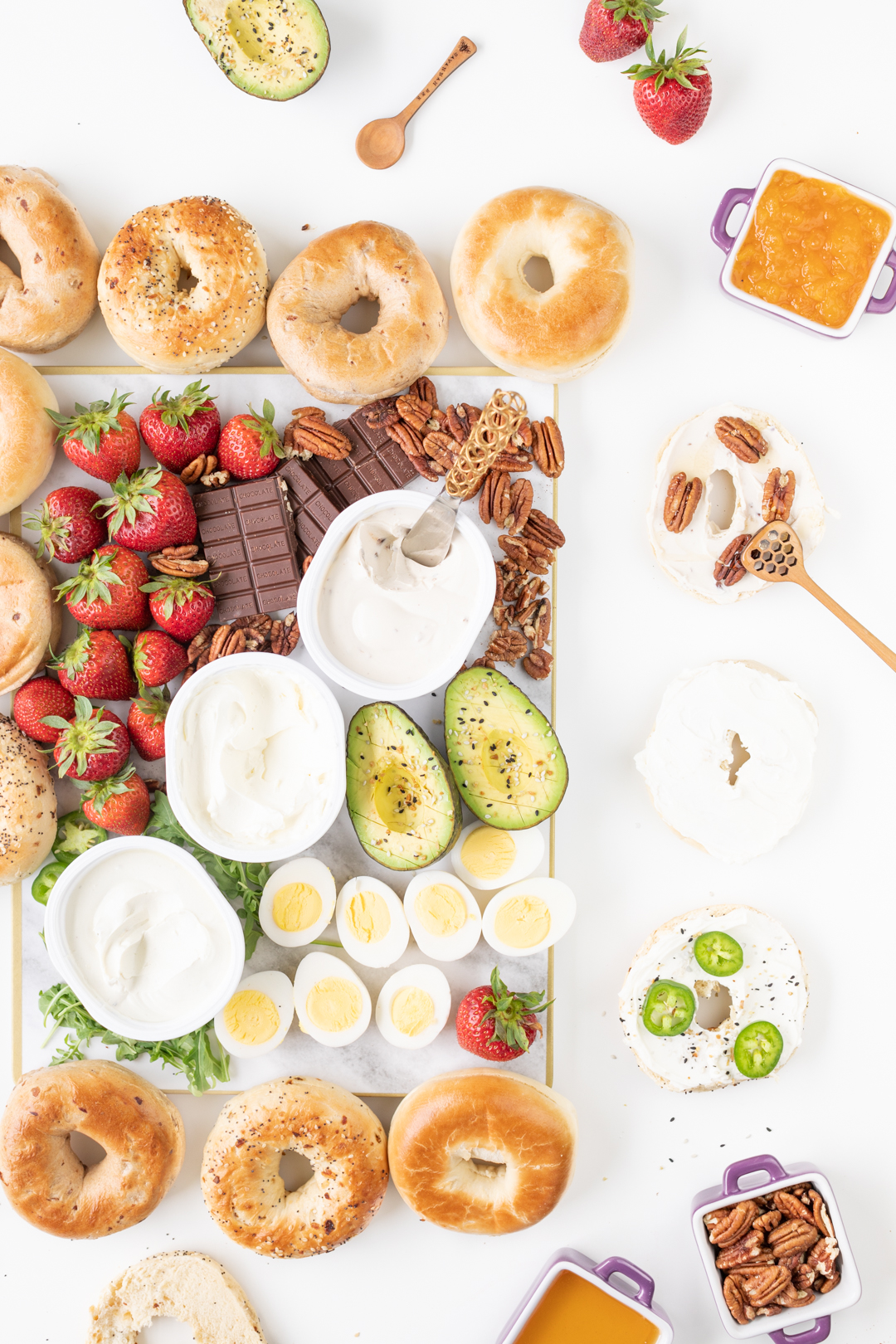 Brunch board with bagels, cream cheese and more delicious toppings.