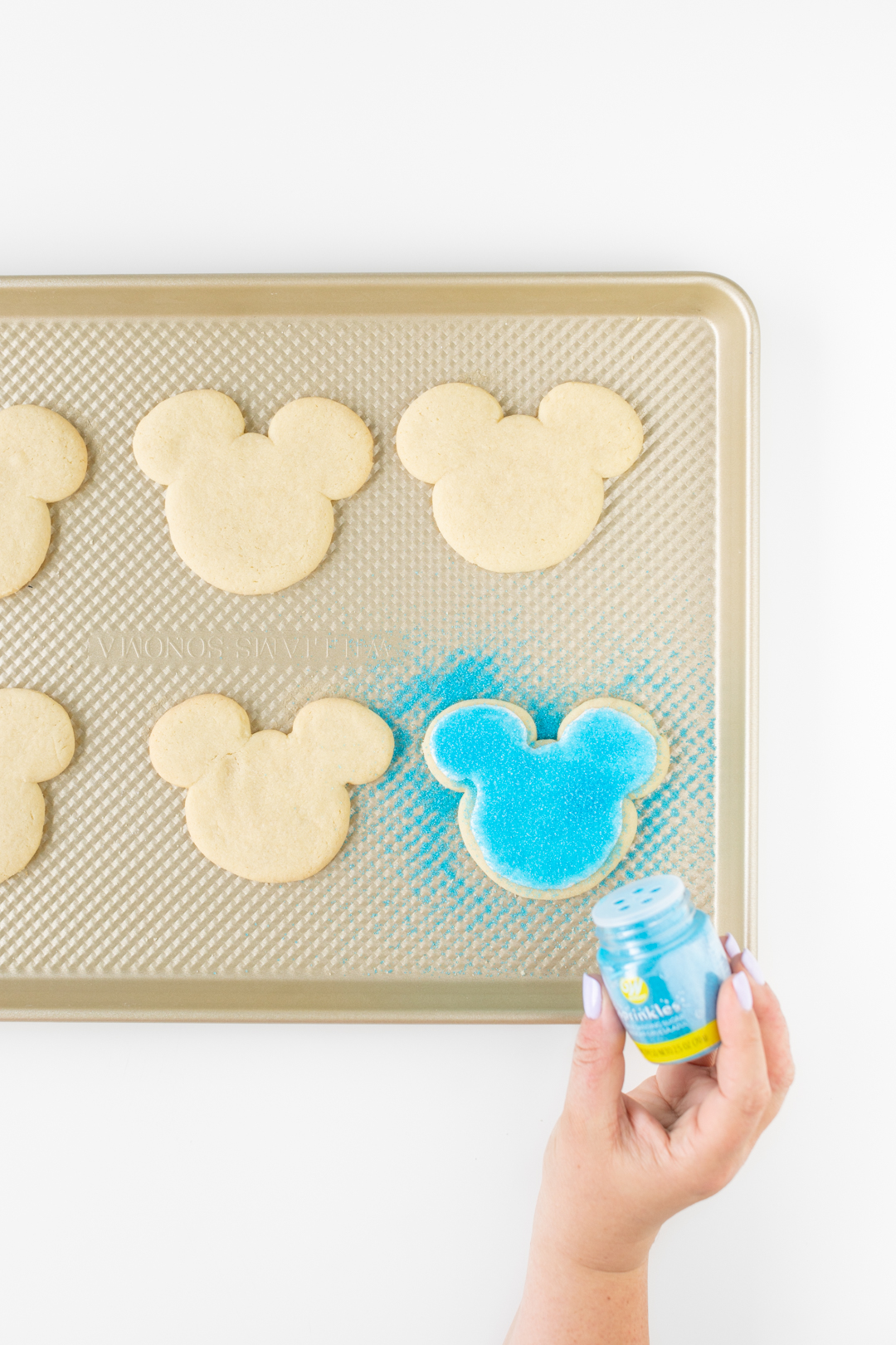 Blue sprinkles on Mickey Mouse Cookies