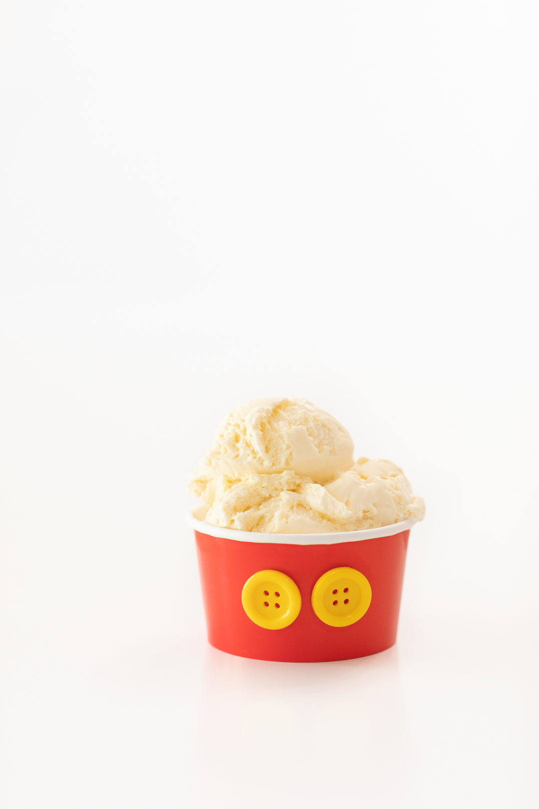 Mickey Mouse Cup with Yellow Buttons and Scoops of Vanilla Ice Cream