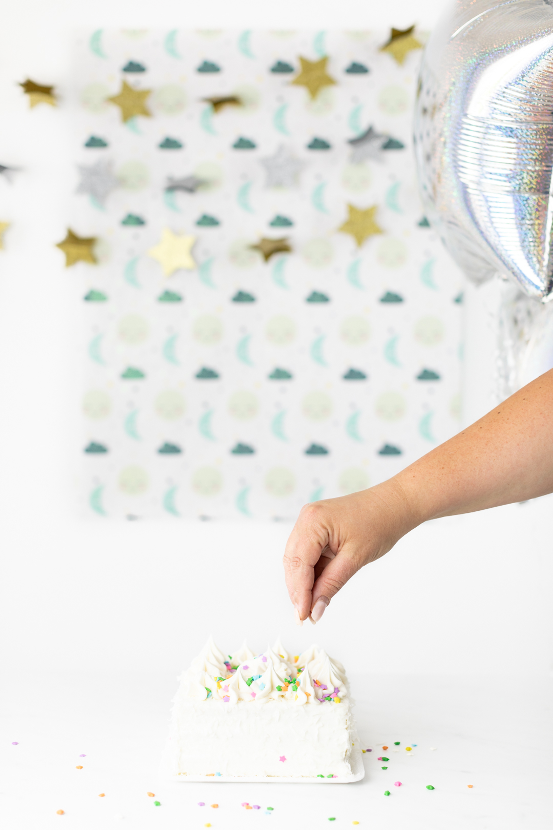 Add star sprinkles to cake