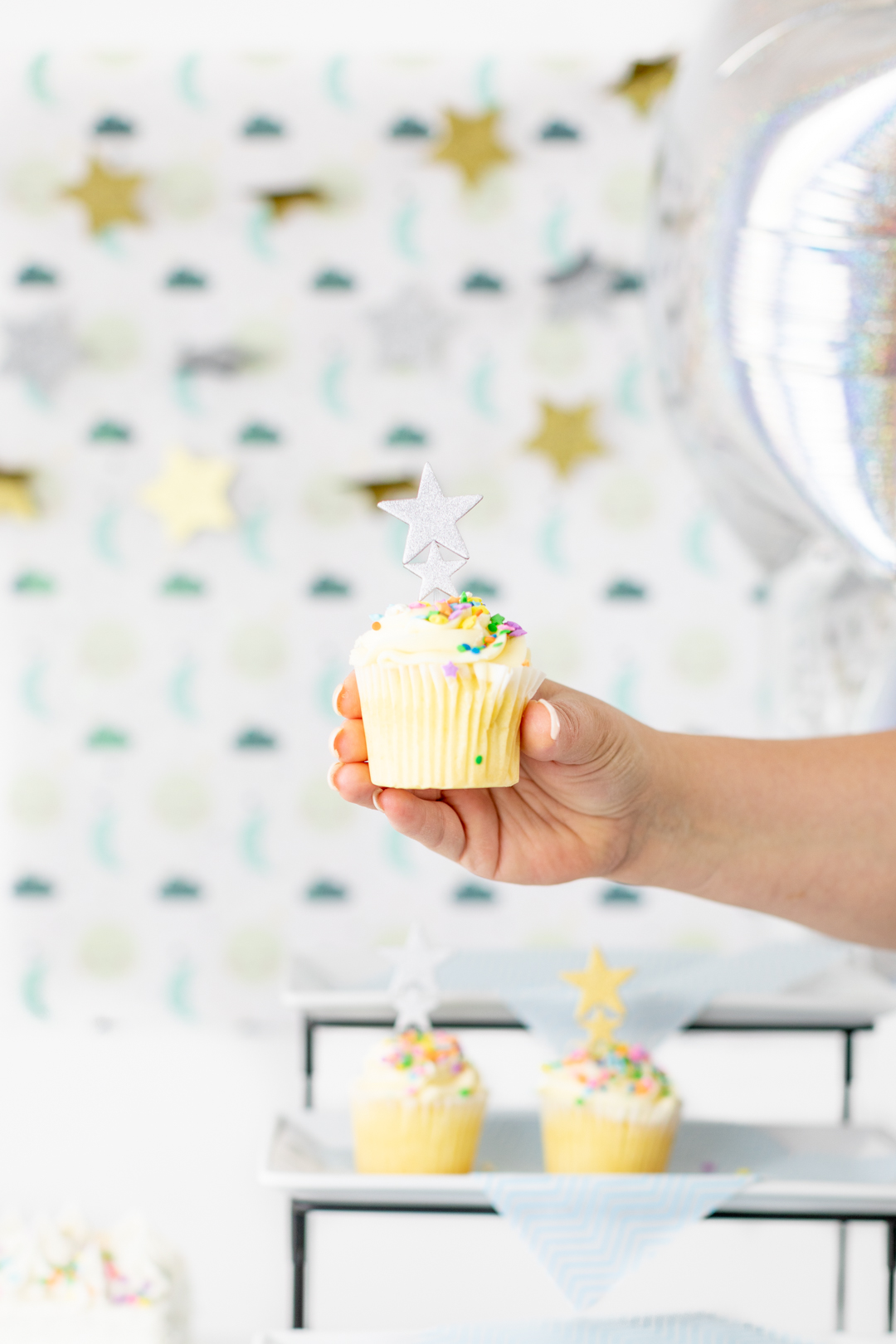 star cupcake in hand
