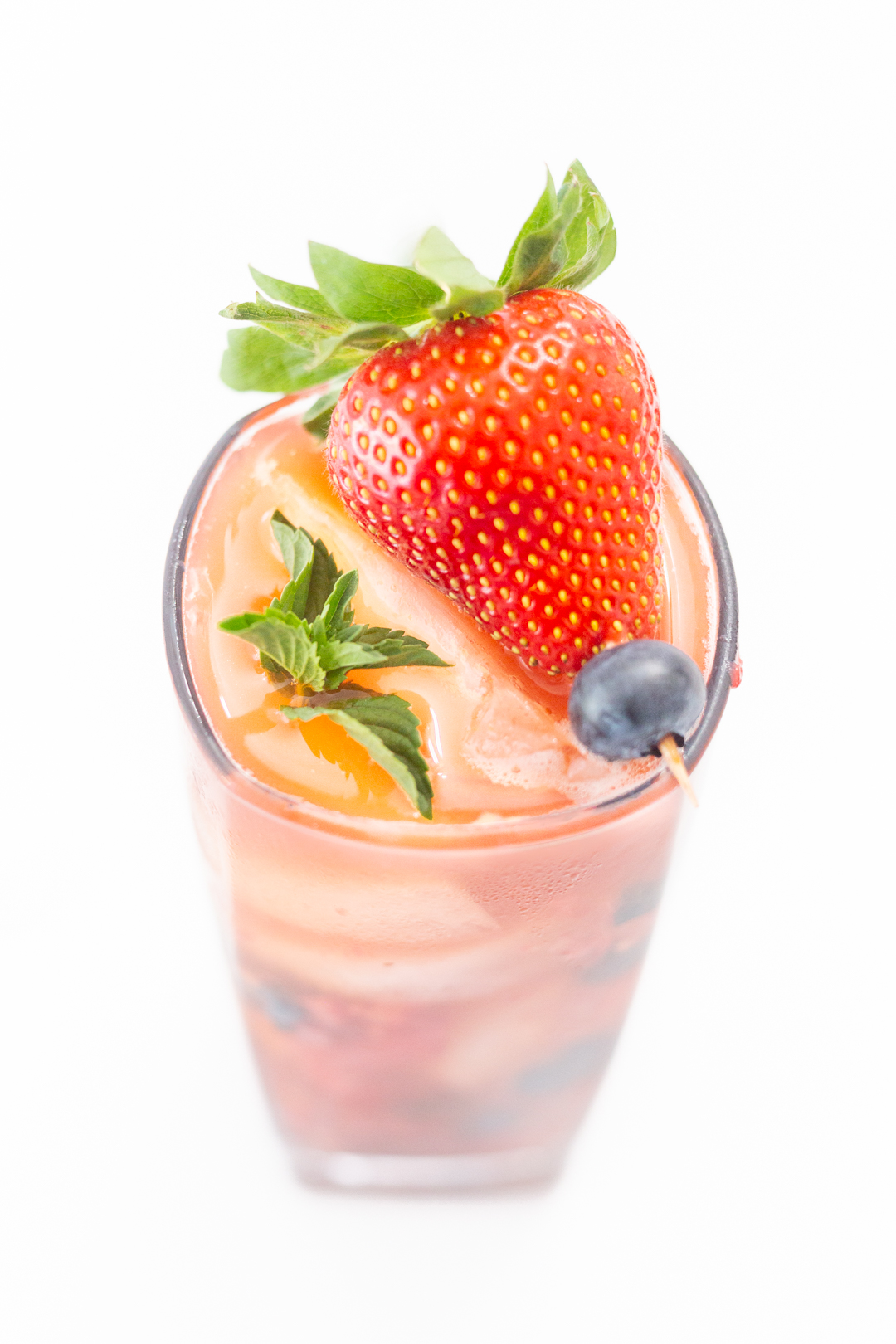 fresh iced tea with strawberry, blueberry and mint