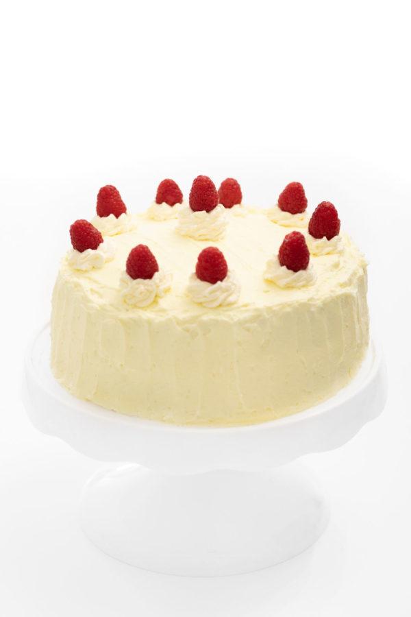 Pretty raspberry cake on a cake stand.