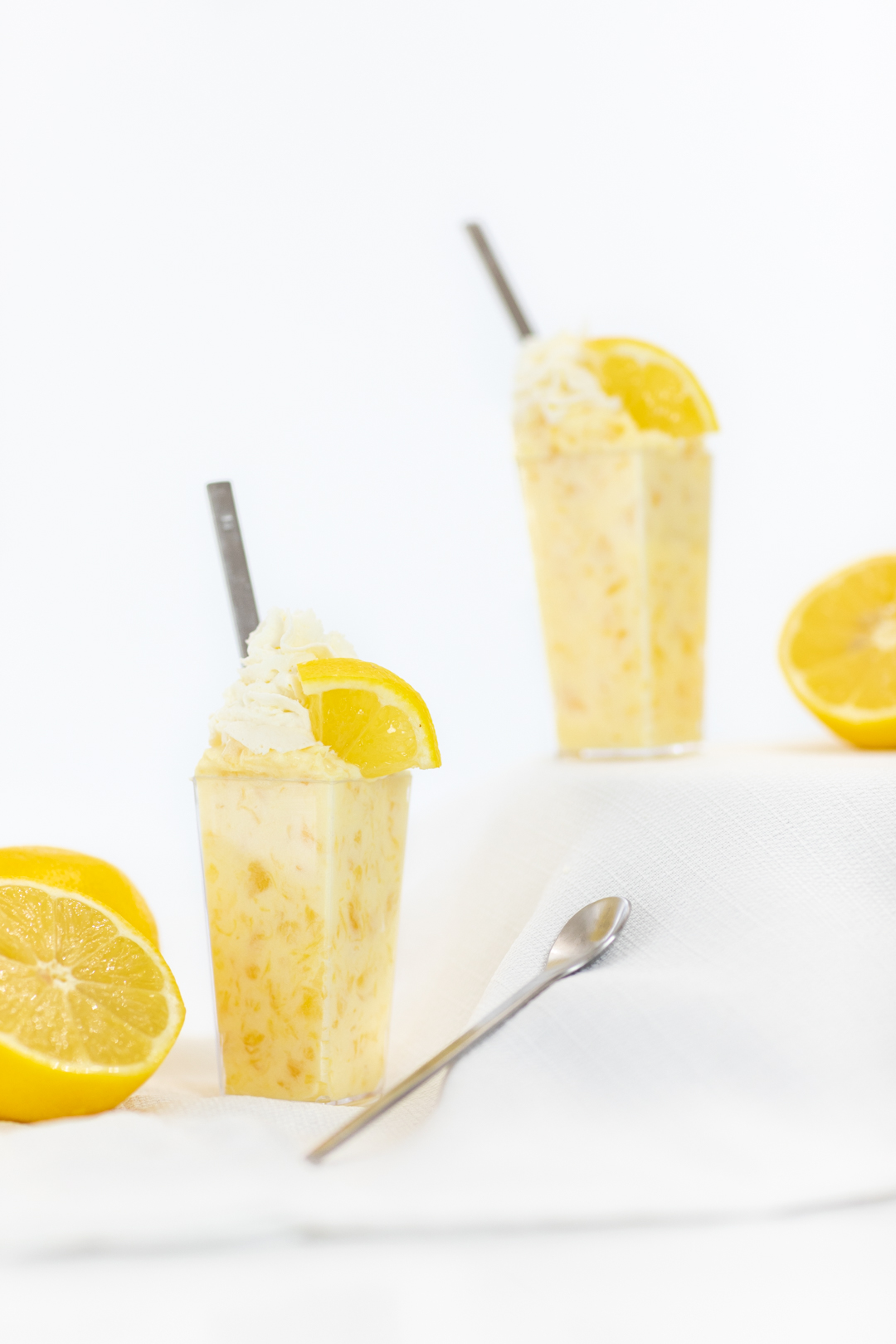 Delish Lemon and Pineapple Dessert Parfait topped with Fresh Lemon Wedges