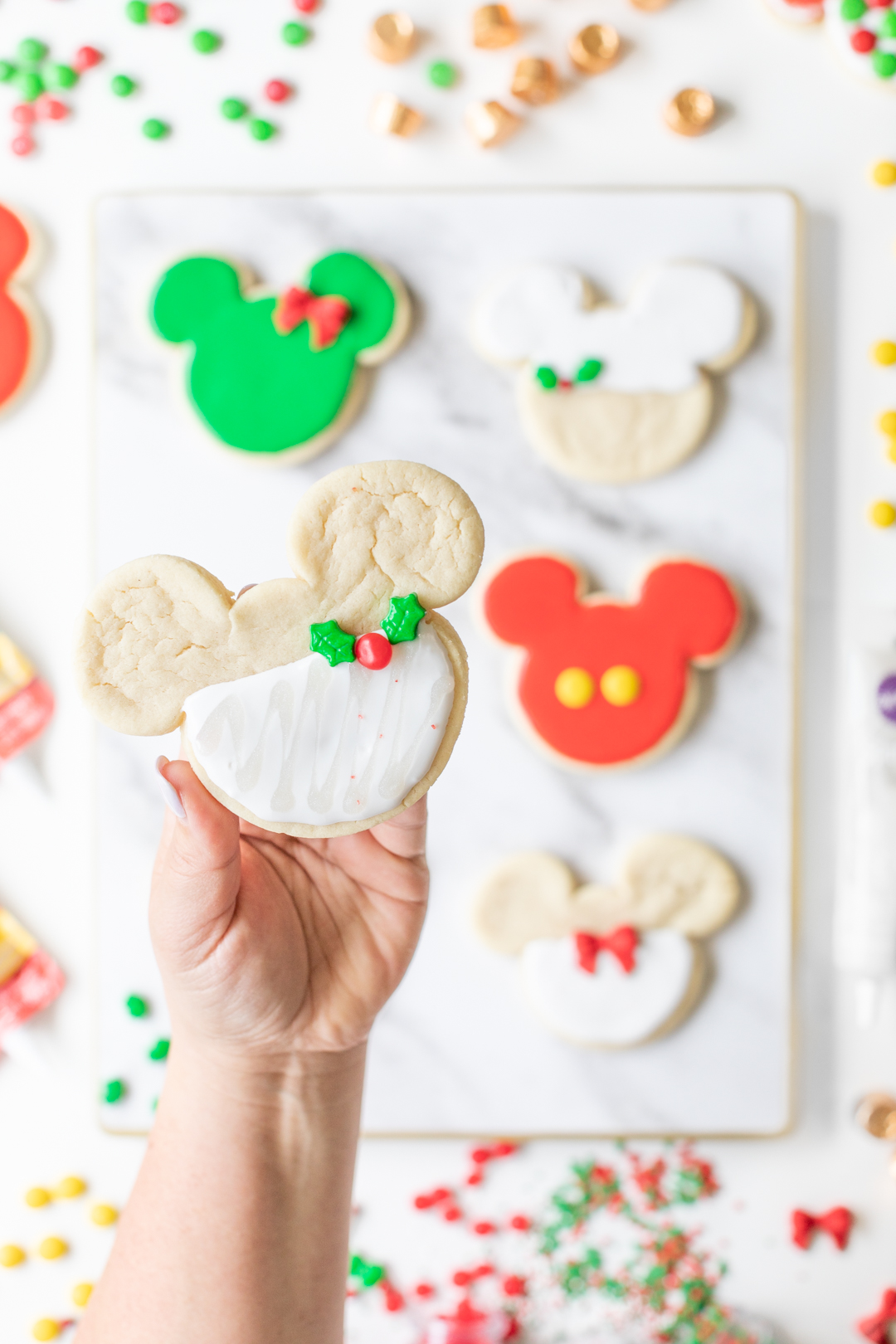 Pretty Mickey Sugar Cookie with White Icing and Holly Sprinkles