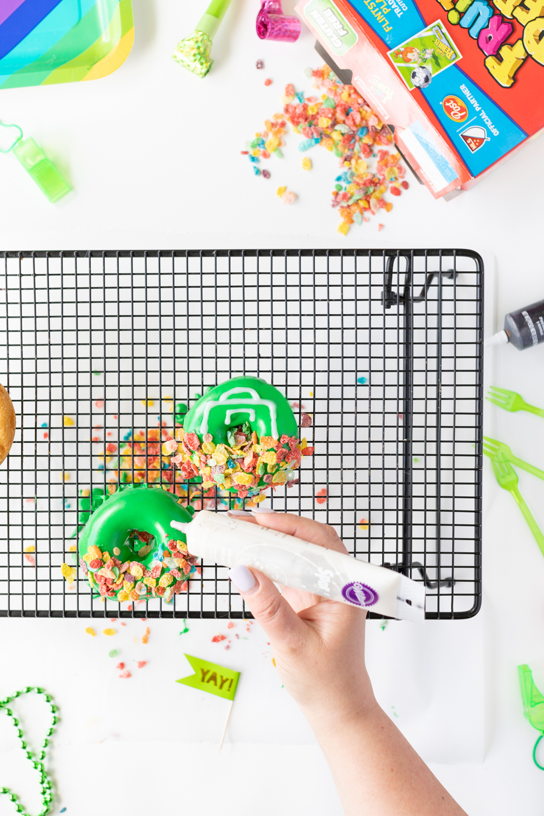 Decorating Donuts with colorful cereal and icing.