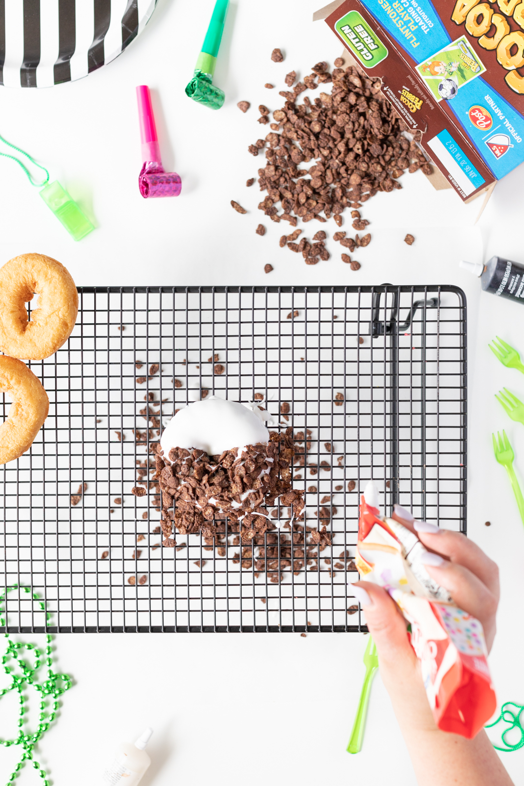 Cocoa Pebbles Donut DIY. Adding Icing.