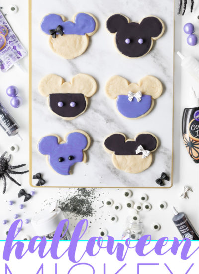 Halloween Mickey Cookies that are Purple and Black to celebrate Haunted Mansion and Ursula and are perfect for Disney Parties.