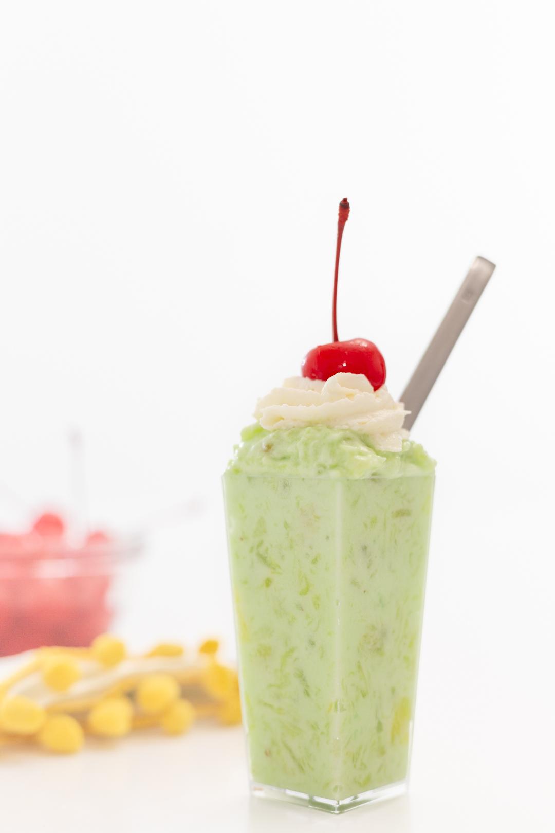 pistachio dessert with cherry on top