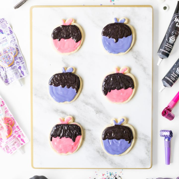 Poison apple cookies with fun and trendy colors for Halloween.
