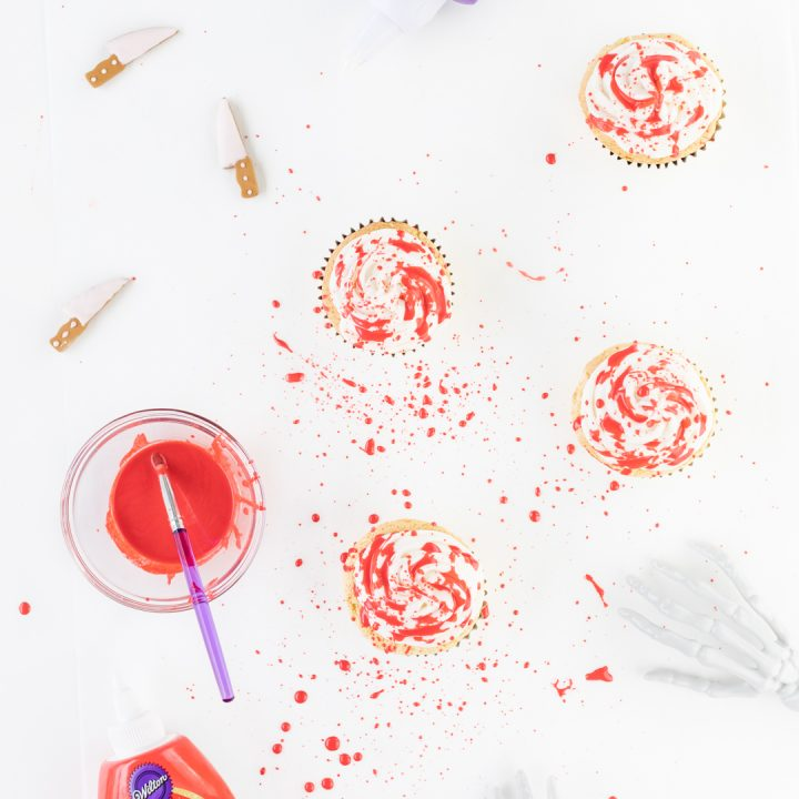 Making Blood Spatter Cupcakes with Red Icing and a food-safe brush.