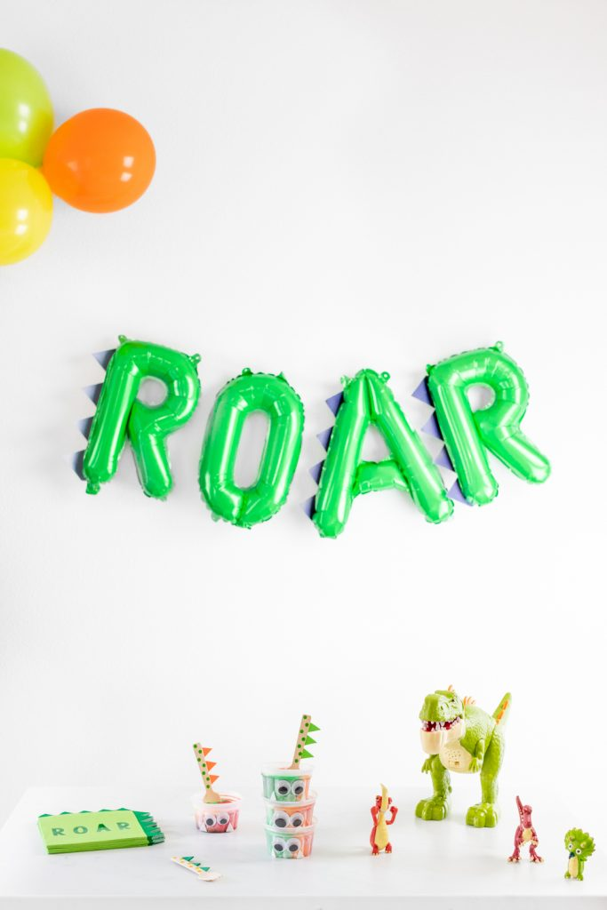 Roar balloon and dinosaur toys and party supplies