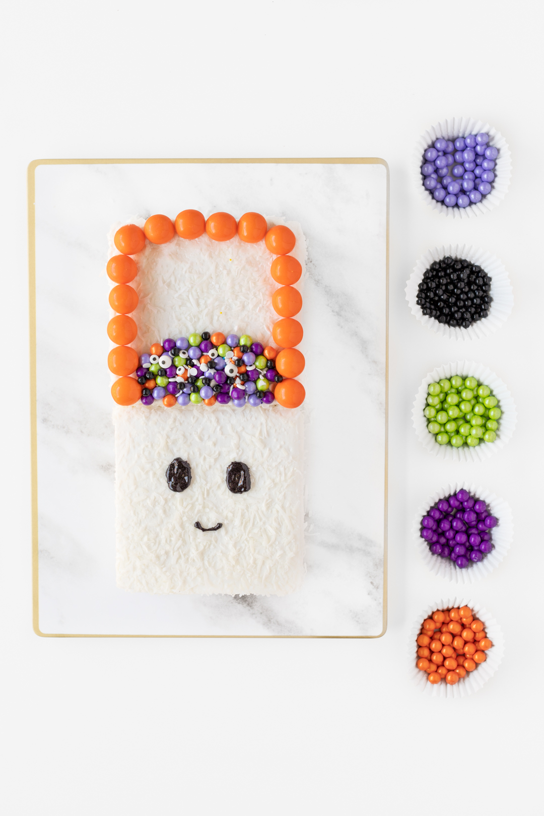 decorating a ghost cake with candies