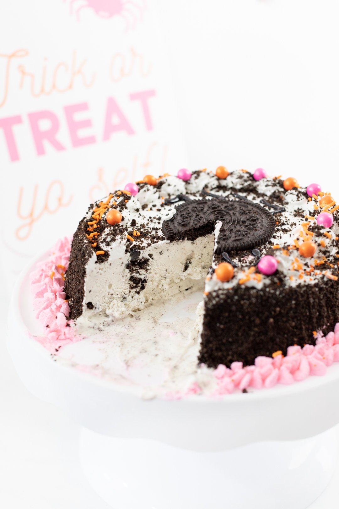 OREO Ice Cream cake with pink and orange embellishments.