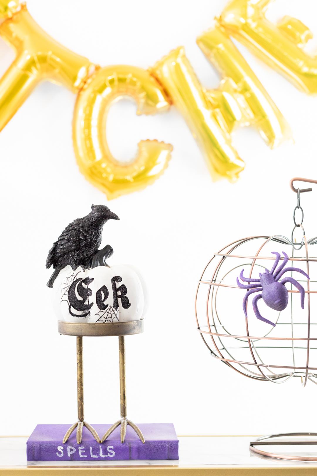 Eek pumpkin with crow on top.