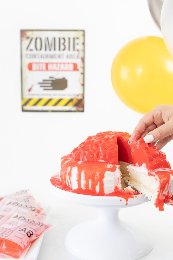Slice of bloody brain cake made with a brain gelatin mold.