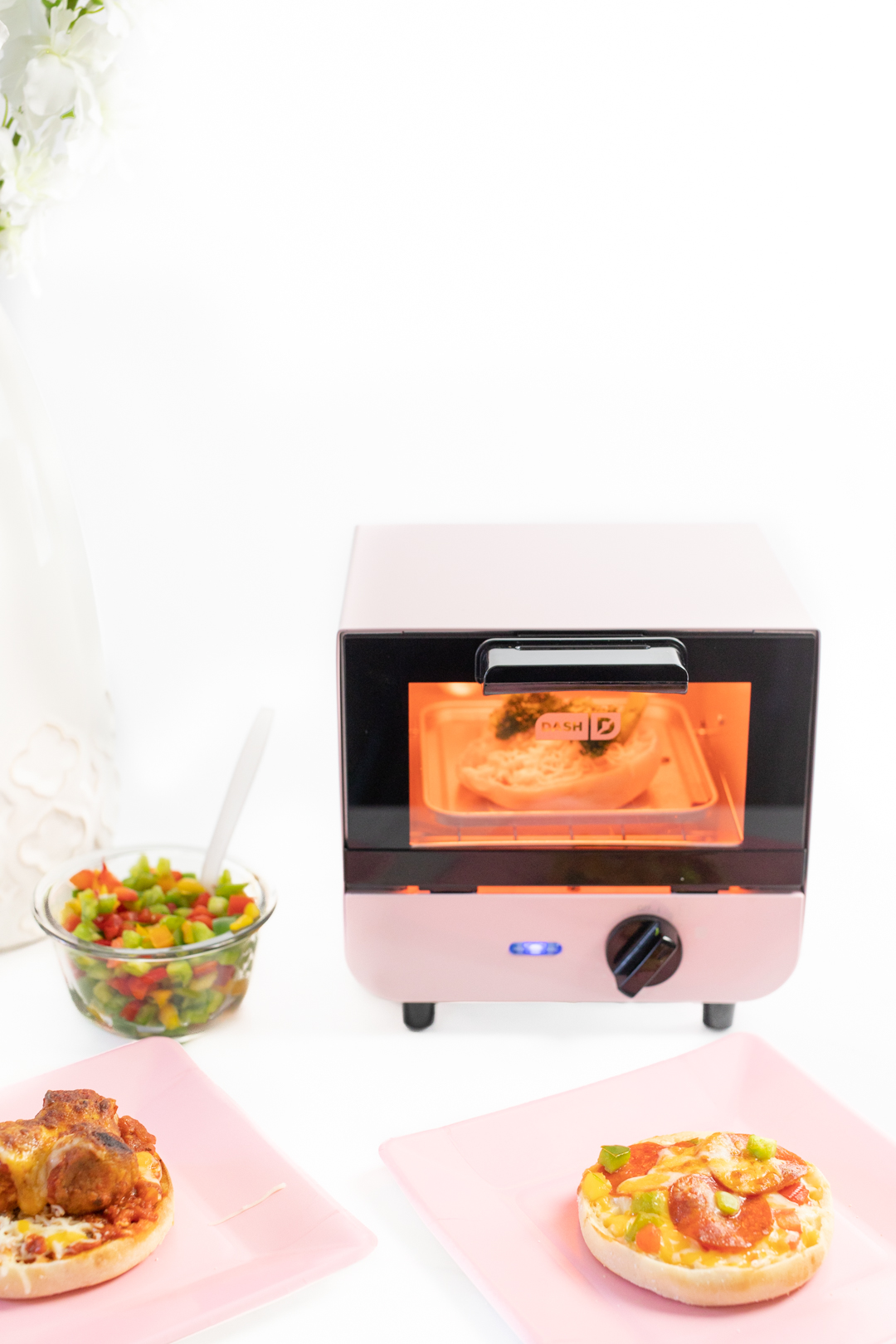 Mini Toaster Oven toasting an english muffin pizza