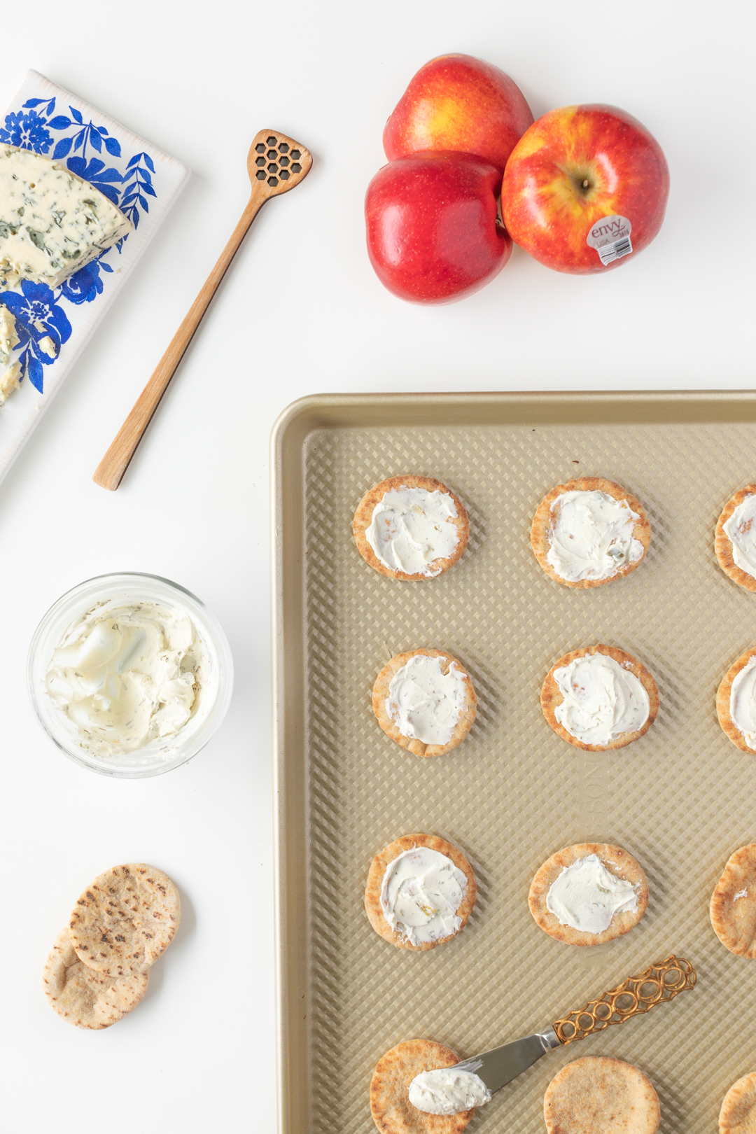 Cream cheese spread over mini pitas
