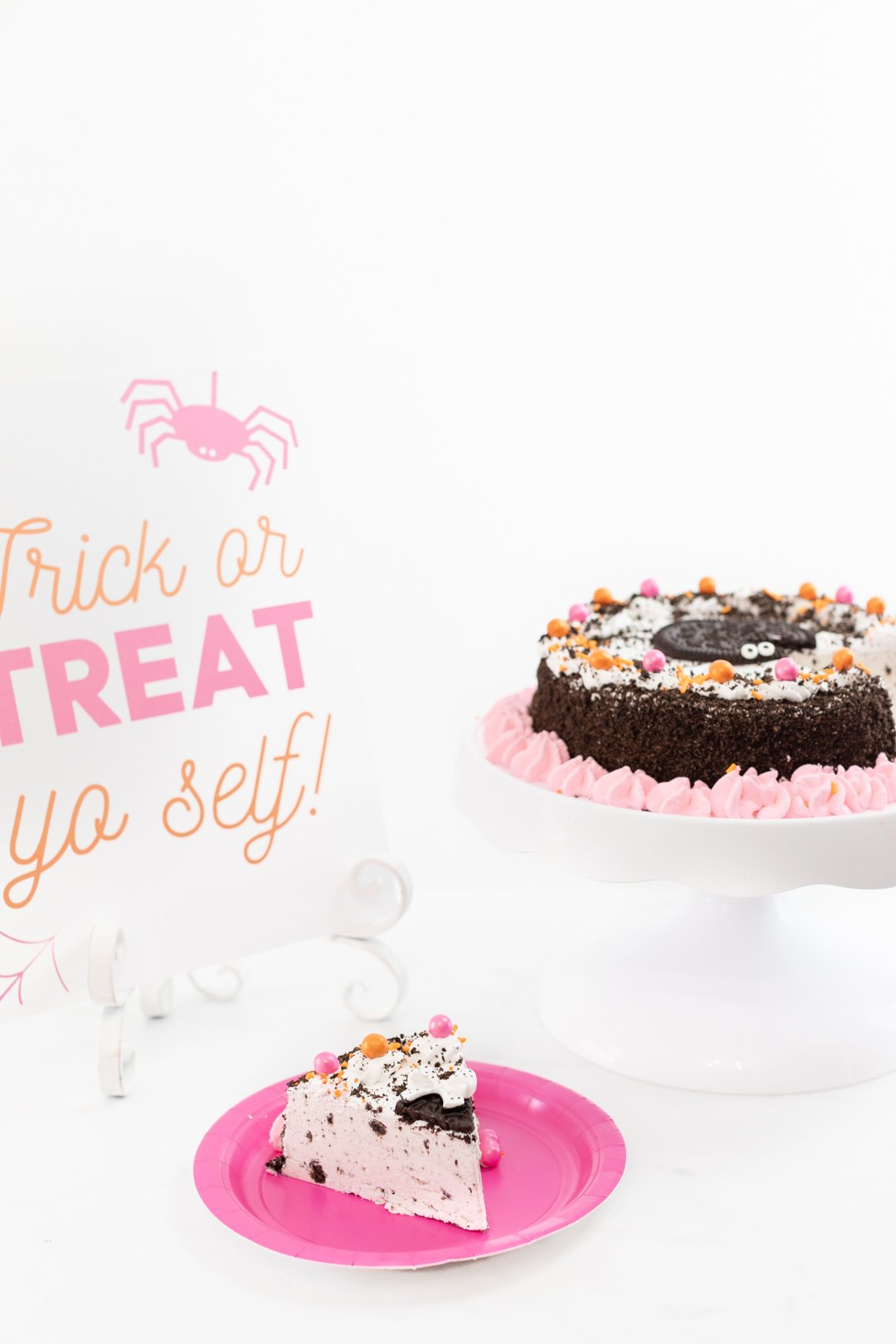 Delish OREO Premium Ice Cream Cake Embellished with pretty pink details for Halloween.