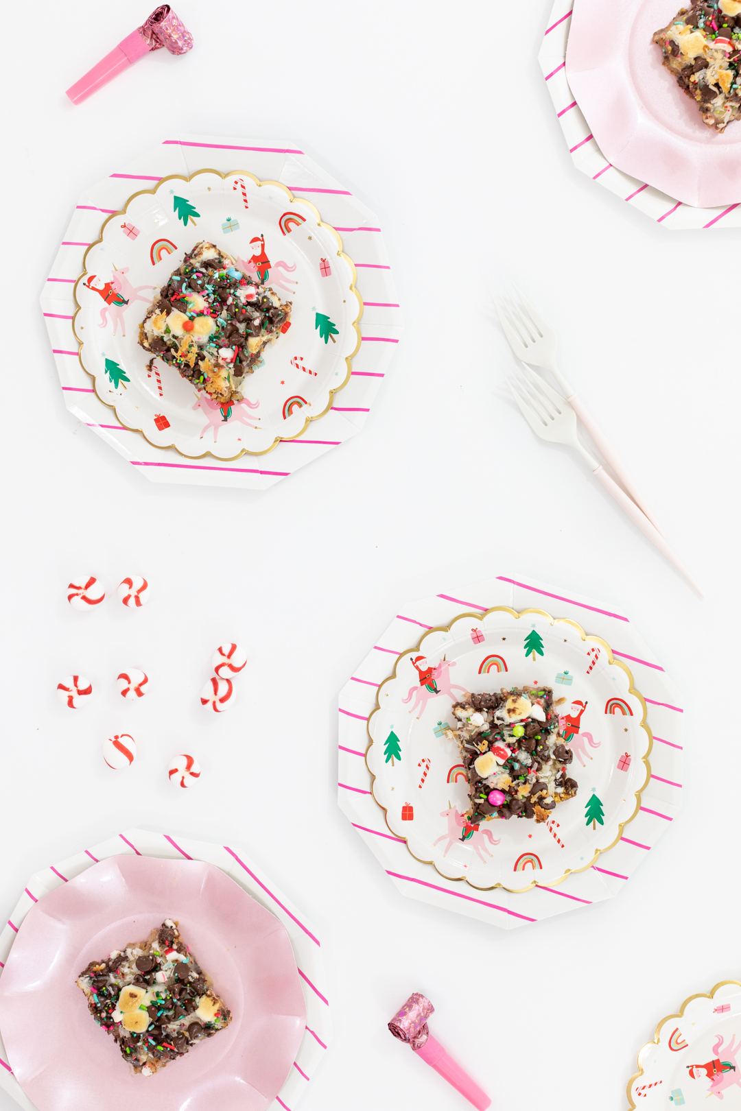 Christmas Magic Layer Bars with pretty sprinkles & pink Christmas party supplies.