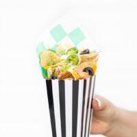 nachos served in a popcorn box