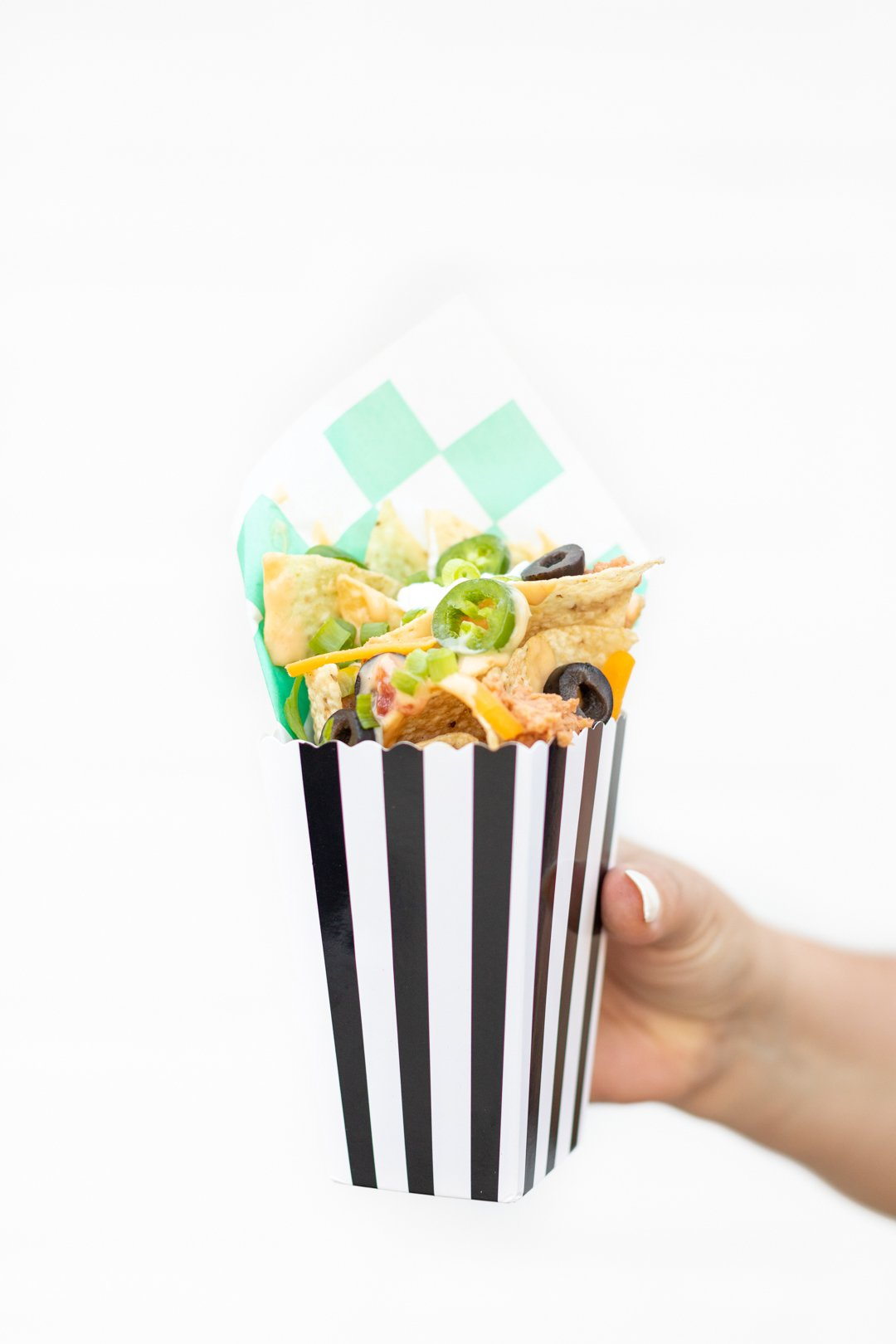 nachos served in a popcorn box