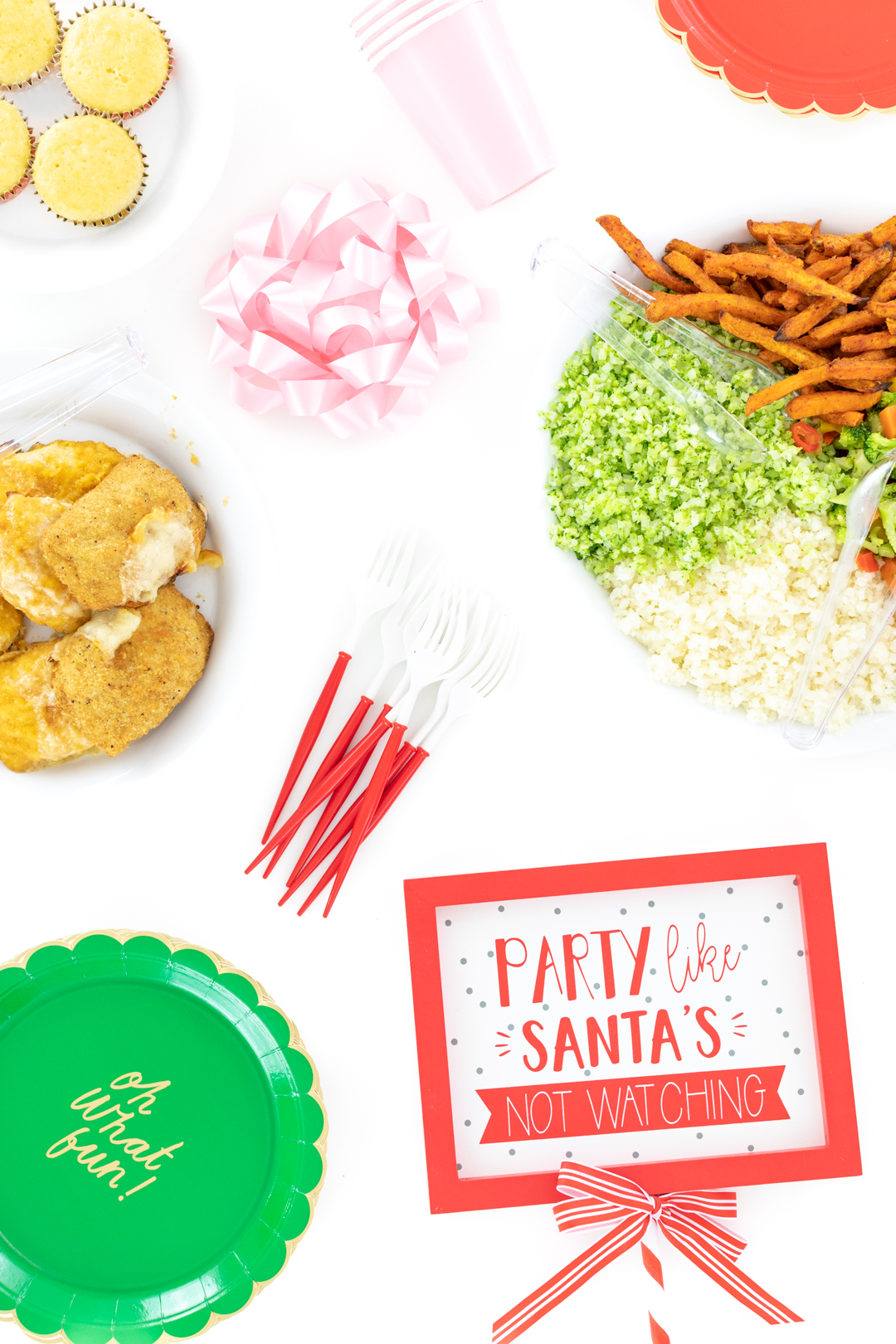 Food spread and Party Like Santa's Not Watching Sign