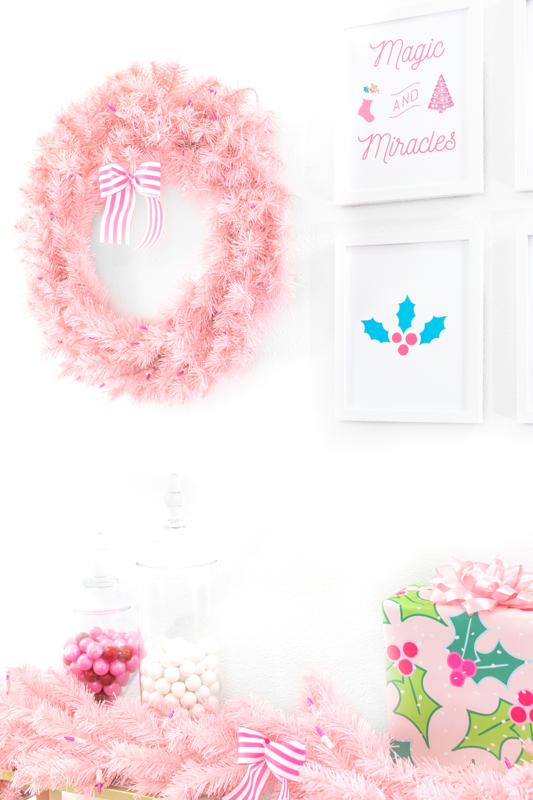 pretty pink christmas display with wreath and wall art