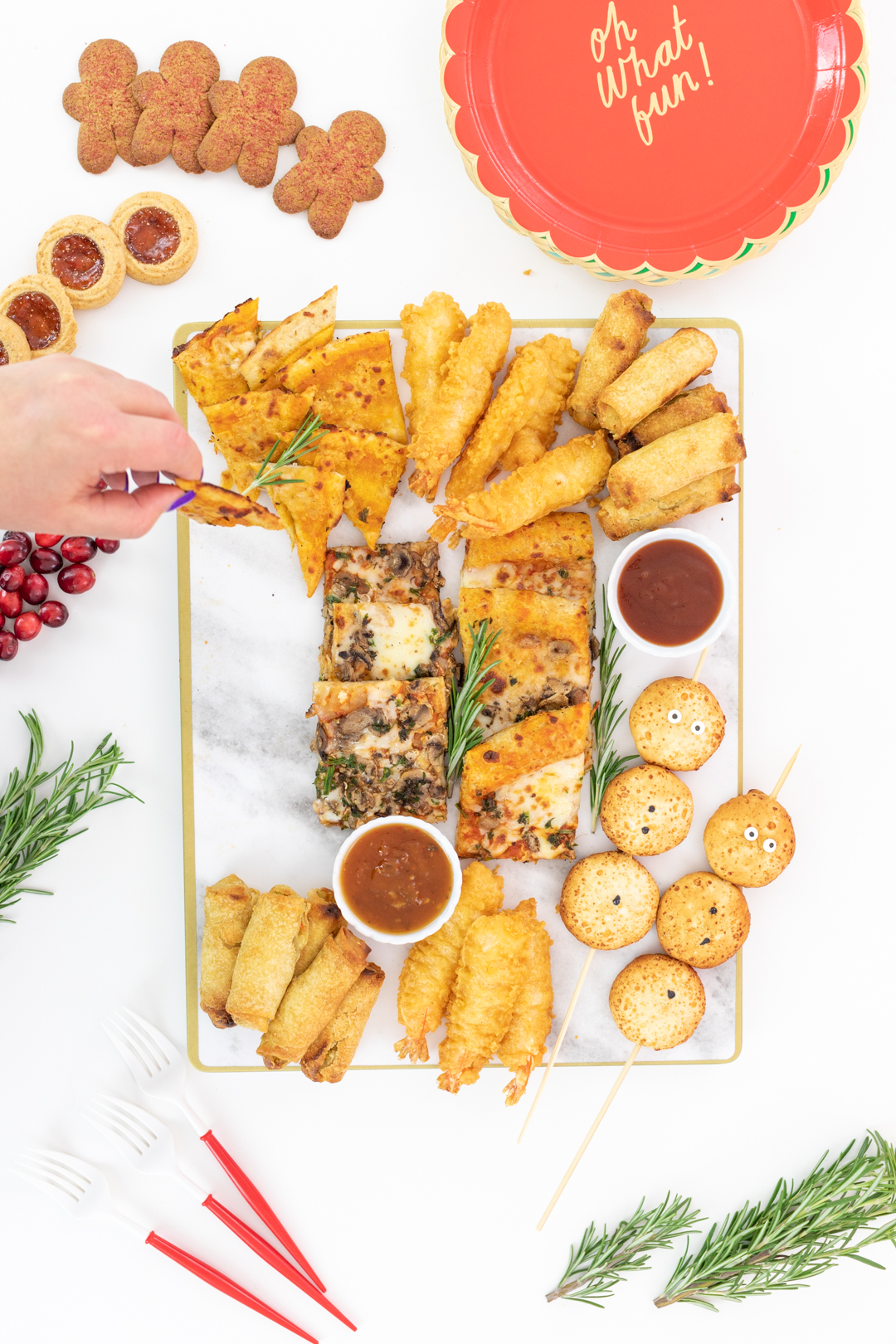 setting up an appetizer board with flatbread, eggrolls and shrimp