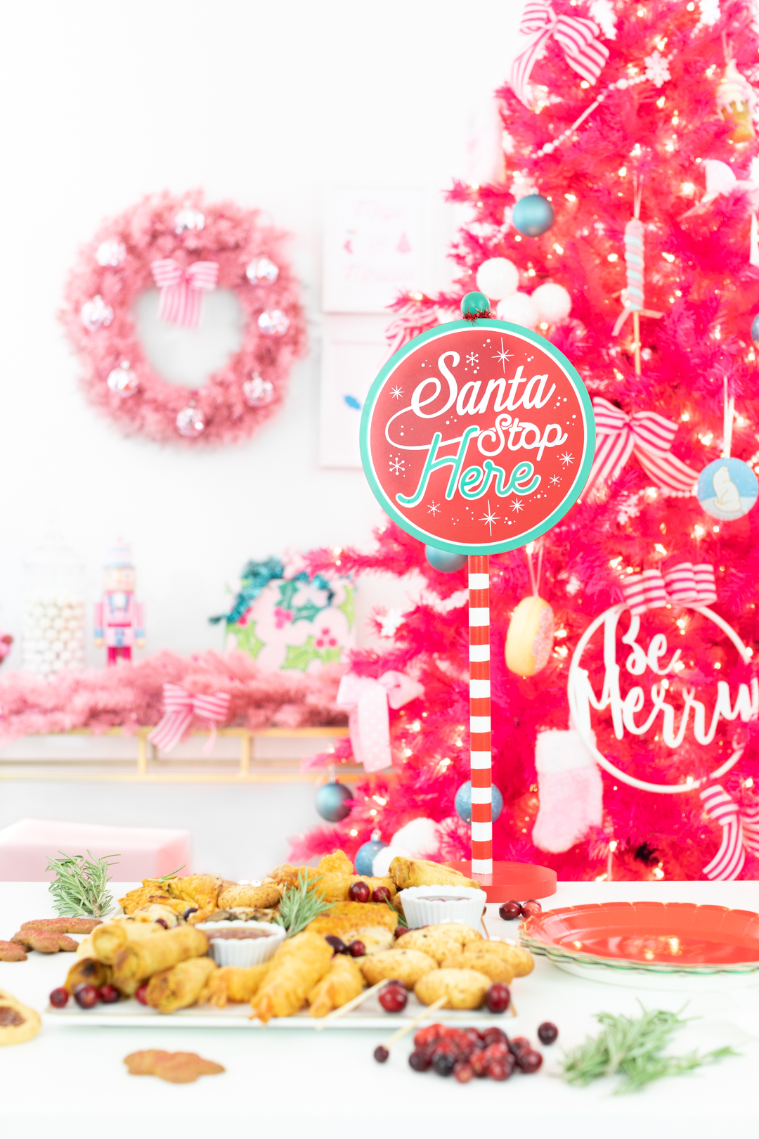 Santa Stop Here Sign from Target with food spread and pink holiday decorations