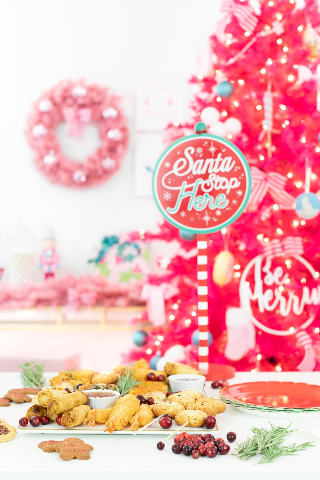 Santa Stop Here Party Sign and holiday snack board spread