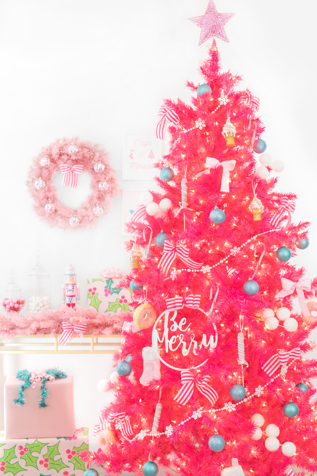 bright pink christmas tree with dessert decorations like candy land