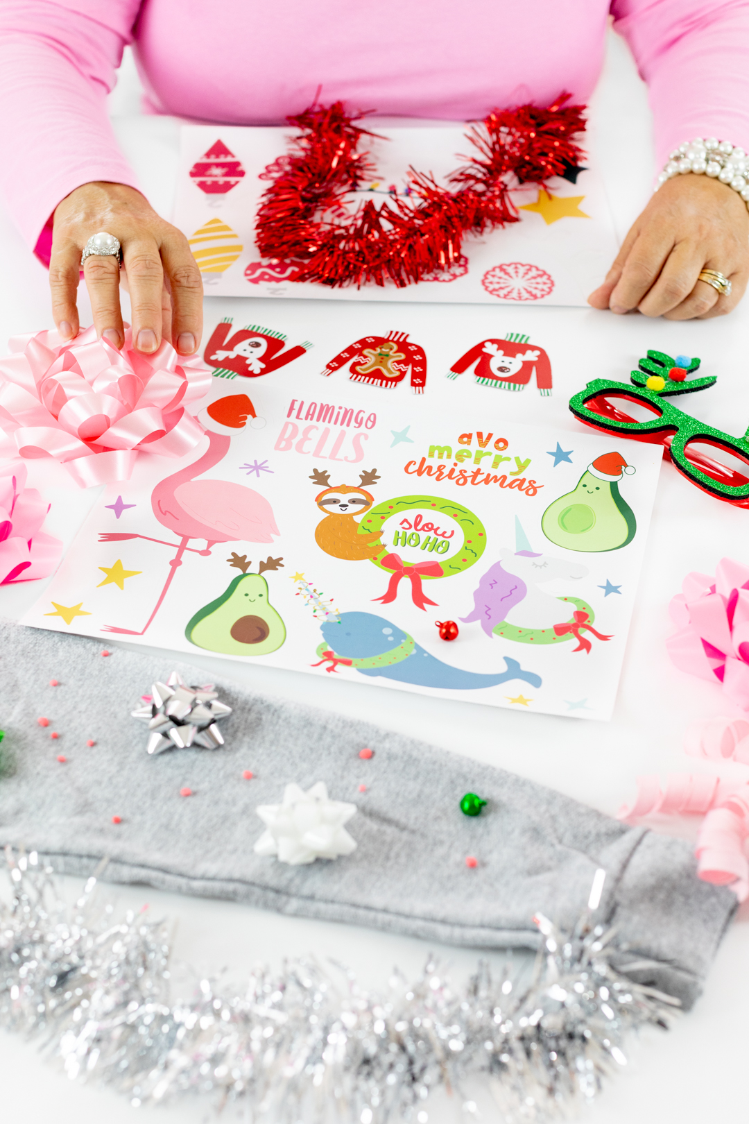 Ugly Sweater DIY Table with stickers, bowls, bells and silly holiday themed glasses.