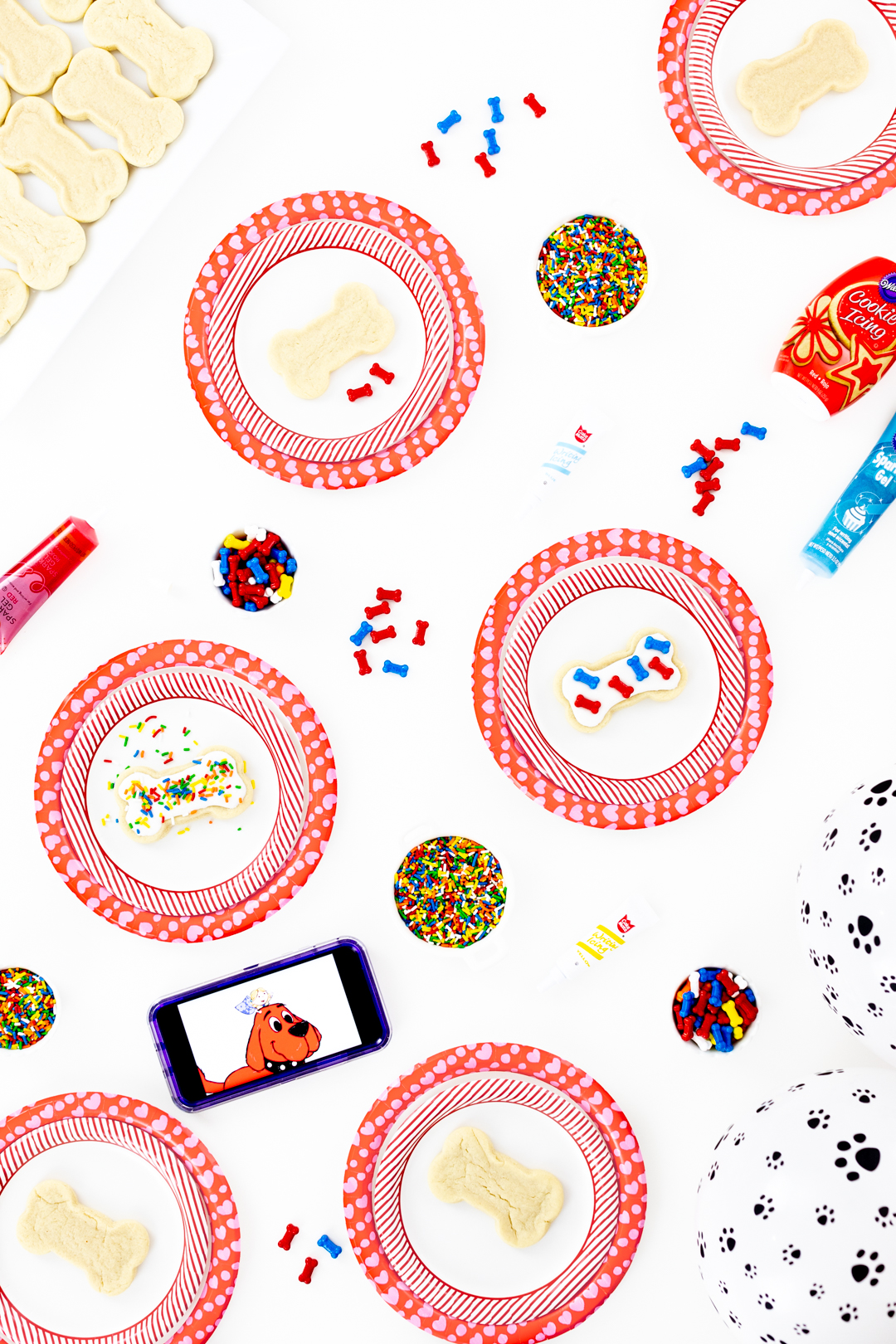 dog party table with dog bone cookies and sprinkles