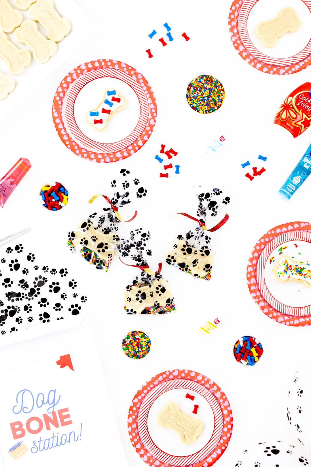 Dog party treat bags with paw prints.