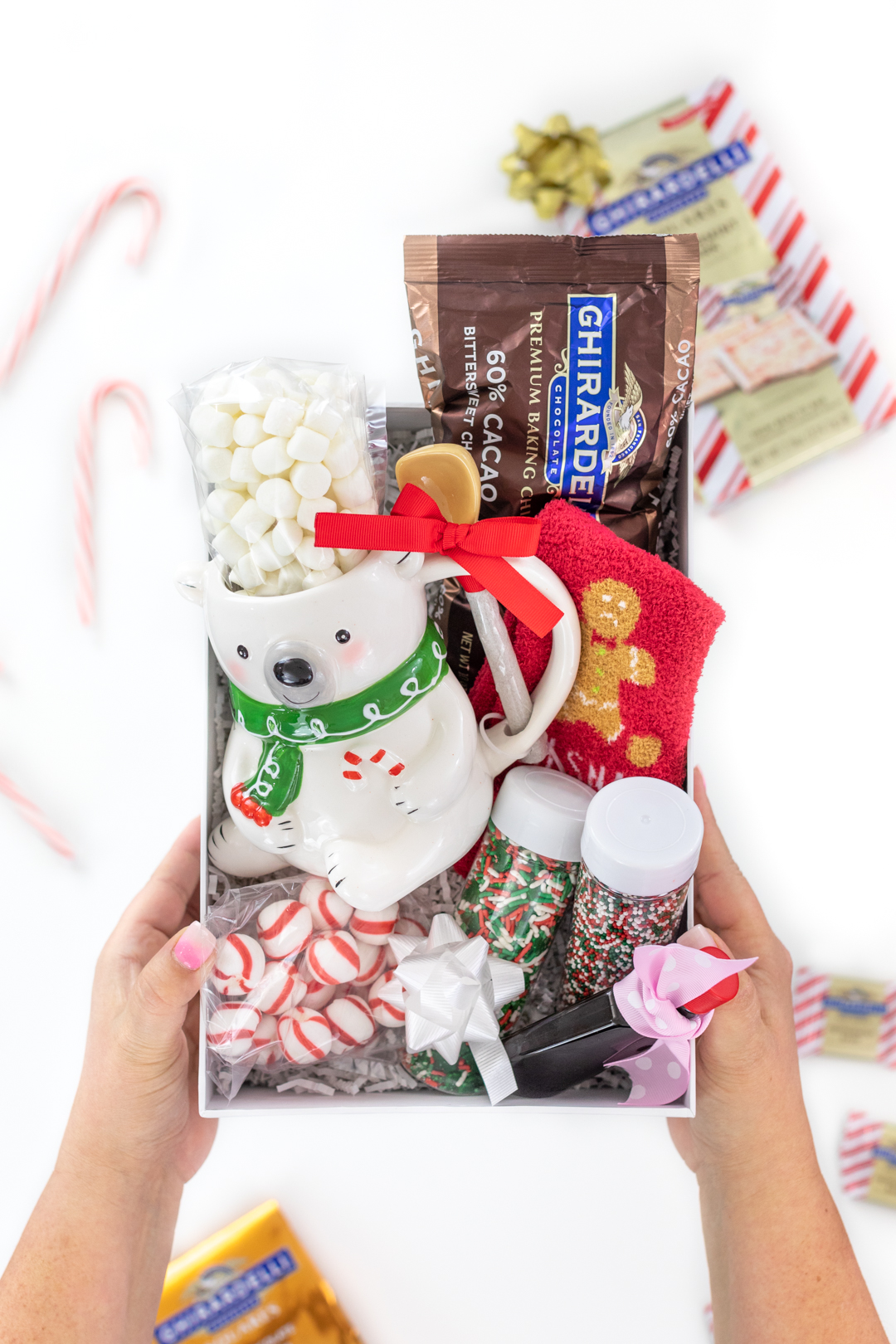 diy hot chocolate gift box with chocolate chips, mini marshmallows, sprinkles, vanilla and a cute polar bear mug