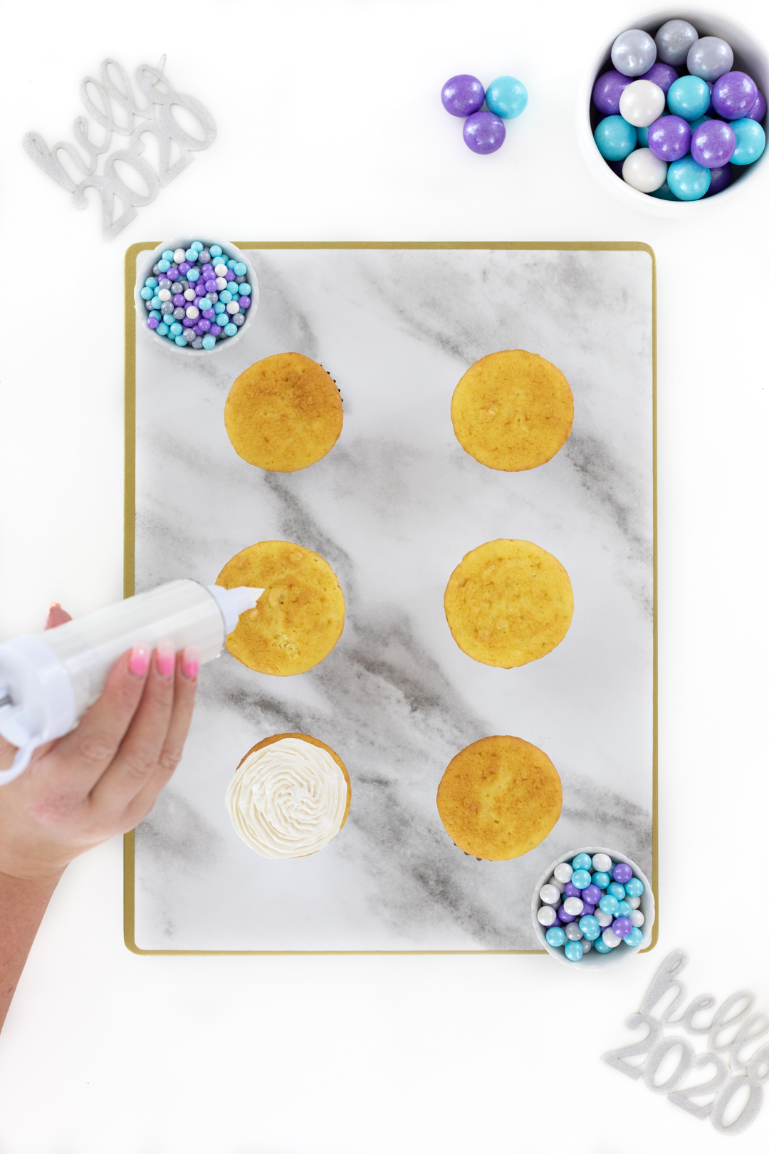putting icing on cupcakes with an easy decorator tool
