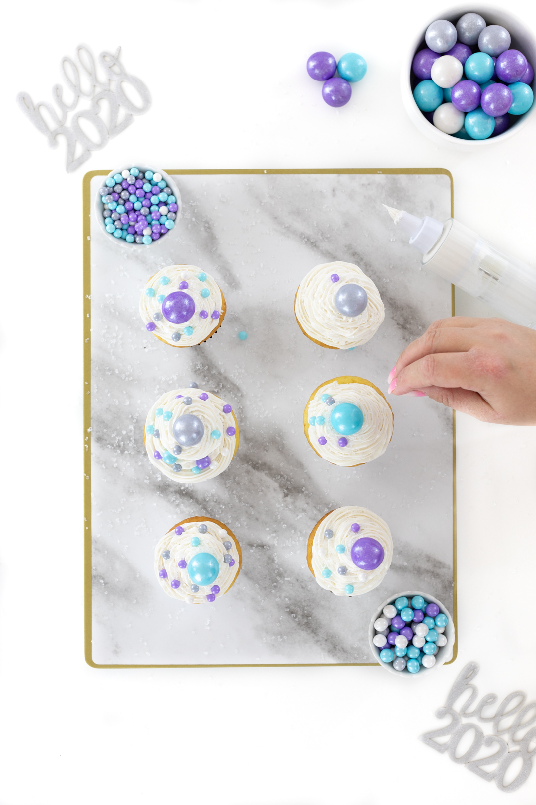 adding final touches to new year cupcakes