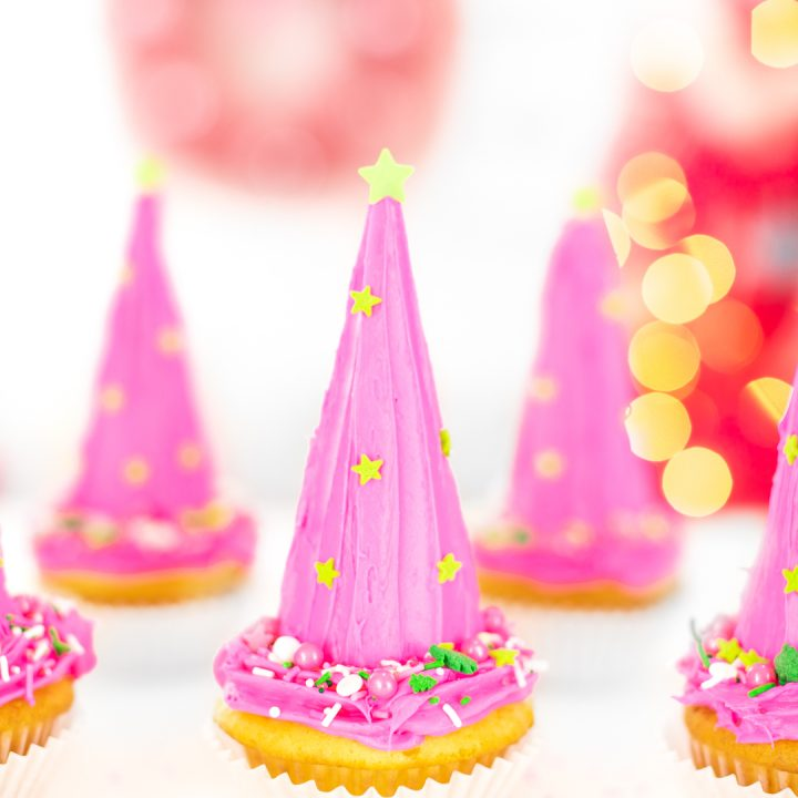pretty christmas tree cupcakes with pink frosting and green touches