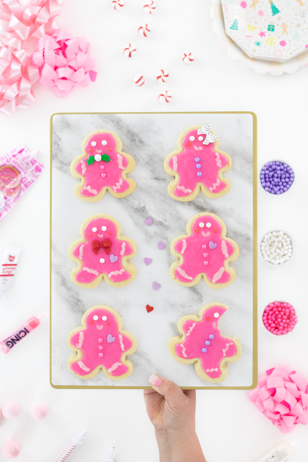 cute pink sugar cookies shaped like gingerbread men