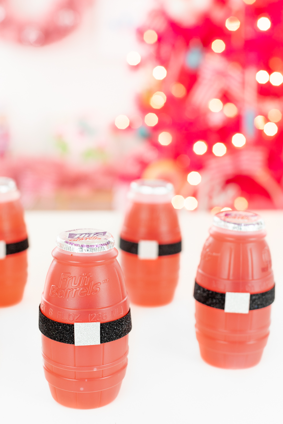 Santa Belt Drinks. Single serve drinks with santa belts.