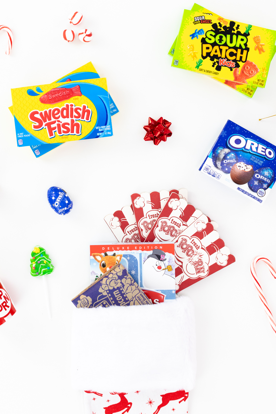 movie themed stocking with fillers like microwave popcorn, candy, popcorn ornament and more