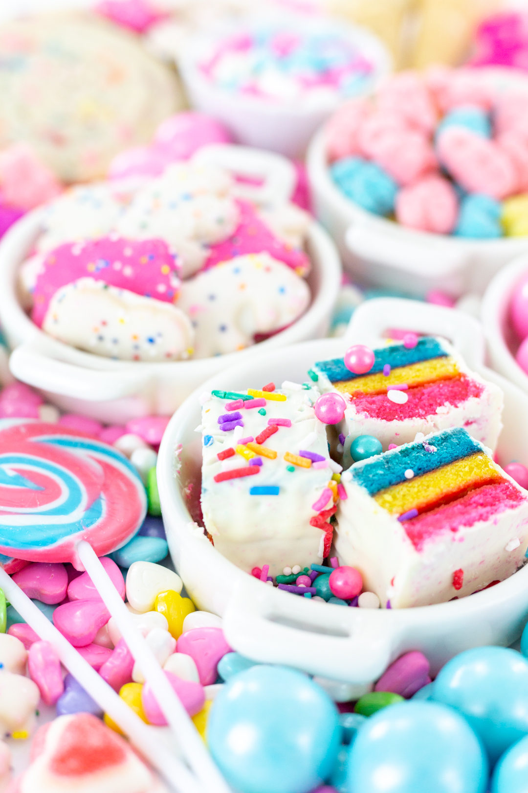 birthday platter with pretty colored cakes and candies